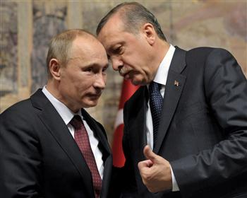 Turkish Prime Minister Recep Tayyip Erdogan, right, and Russian President Vladimir Putin speak to each other at a news conference in Istanbul, Turkey, Monday, Dec. 3, 2012. The leaders of Russia and Turkey on Monday downplayed differences over the Syrian civil war, saying they shared the common goal of trying to end the humanitarian crisis there and hailing their countries' booming trade ties. (Courtesy photo - credit Alexei Nikolsky, Presidential Press Service)