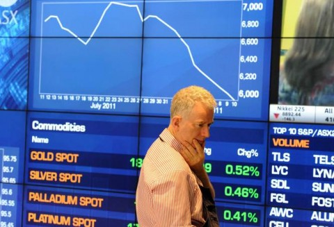 An investor watches market indices monitors at the Australian Stock Exchange (ASX) during morning trade in Sydney (Courtesy photo - The Conversation)