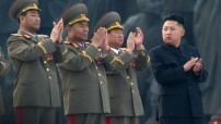 Kim Jong-Un (R) clapping as he attends the unveiling ceremony of two statues of former leaders Kim Il-Sung and Kim Jong-Il in Pyongyang as North Korea's army chief Ri Yong-Ho (2nd L) applauds with other senior members of the military.  North Korea's army chief Ri Yong-Ho  has been removed from all his posts due to illness, state media announced on July 16, 2012, which analysts said showed new leader Kim Jong-Un tightening his control over the powerful military. (Courtesy photo - edu.only)