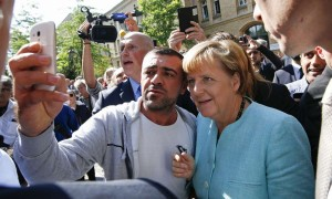 Angela Merkel with Syrian refugees in Germany 2015 (Courtesy news photo for education only Creat/Comm)