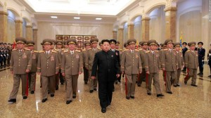Kim with his military and communist entourage (Courtesy CNN photo for education only)
