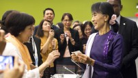 Aung San Suu Kyi (right), Chairperson and General Secretary of the National League for Democracy of Myanmar, meets with members the UN Staff Recreation Council Myanmar Club and their families. 21 September 2012 United Nations, New York (UN photo Rick Barons)