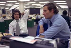 Reporters Bob Woodward, right, and Carl Bernstein, whose reporting of the Watergate case won them a Pulitzer Prize, sit in the newsroom of The Washington Post in Washington, May 7, 1973. (VOA File photo)