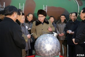 Photo: Kim Jong Un, with what North Korea claims is a miniaturized silver spherical nuclear bomb, at a missile factory in early 2016. Credit: Wikimedia Commons.