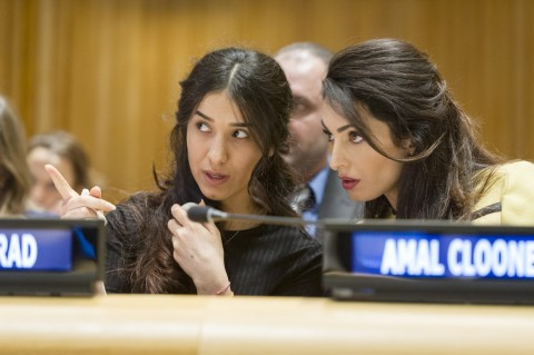 """Nadia Murad Basee Taha (left), UNODC (UN Office on Drugs and Crime) Goodwill Ambassador for the Dignity of Survivors of Human Trafficking and Yazidi survivor of trafficking at the hands of ISIL (Da'esh), with Amal Clooney, Barrister at Doughty Street Chambers and Legal Representative for Yazidi survivors, during the high-level event on """"The Fight against Impunity for Atrocities: Bringing Da'esh to Justice"""". The event was co-organized by the Permanent Missions of Belgium, Canada, Germany, Iraq and the United Kingdom 09 March 2017 (UN photo by Rick Bajornas)"""