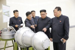"Photo by Korean Central News Agency (KCNA), showing North Korean leader Kim Jong Un visited the country's Nuclear Weapons Institute and later watched what Pyongyang describes as an ""H-bomb"" (hydrogen bomb) being loaded onto a missile. (Photo for education only)"