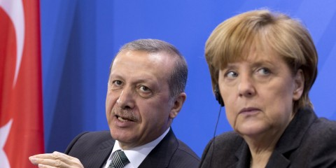 German Chancellor Angela Merkel, right,  listens  as Turkey's Prime Minister Recep Tayyip Erdogan, left,  speaks  during a joint press conference after a meeting at the chancellery in Berlin, Germany, Tuesday, Feb. 4, 2014.  ( Courtesy photo for education only - Credit AP Photo/Axel Schmidt)