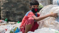 Twelve-year-old boy in Dhaka, capital of Bangladesh, sorts through hazardous plastic waste without any protection, working to support his family amidst the coronavirus lockdown. Credit: UNICEF/Parvez Ahmad