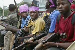 Child soldiers patrolling in Monrovia, Liberia (Ground report  photo for education only)