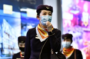 Flight attendants with masks which are a must (Photo for education only)
