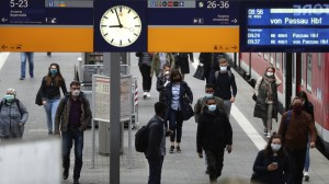 Travelers wear face masks to protect against the spread of the coronavirus at the central station in Munich on Monday. Masks became mandatory in parts of Germany for people shopping and using public transport. (Courtesy photo NPR - for education only).